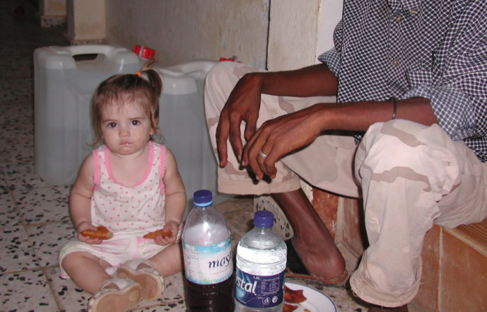Lucy two-fisting samboosas and breaking the fast with Yusuf